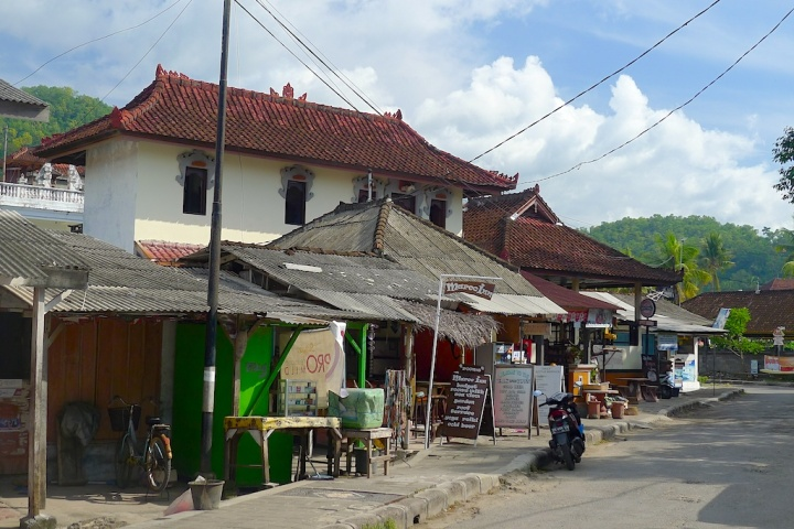 This is the main drag, over the road from the beach in Padang Bai. If you look carefully you'll see the Marco Inn sign. The hotel is down a small alleyway which leads into a jasmin scented courtyard.  © Roger Garwood 2013