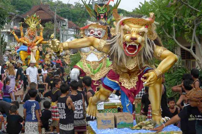 The beginning of the parade in Padang Bai. most of these horrific effigies of evil spirits are made by school children. © Roger Garwood 2013