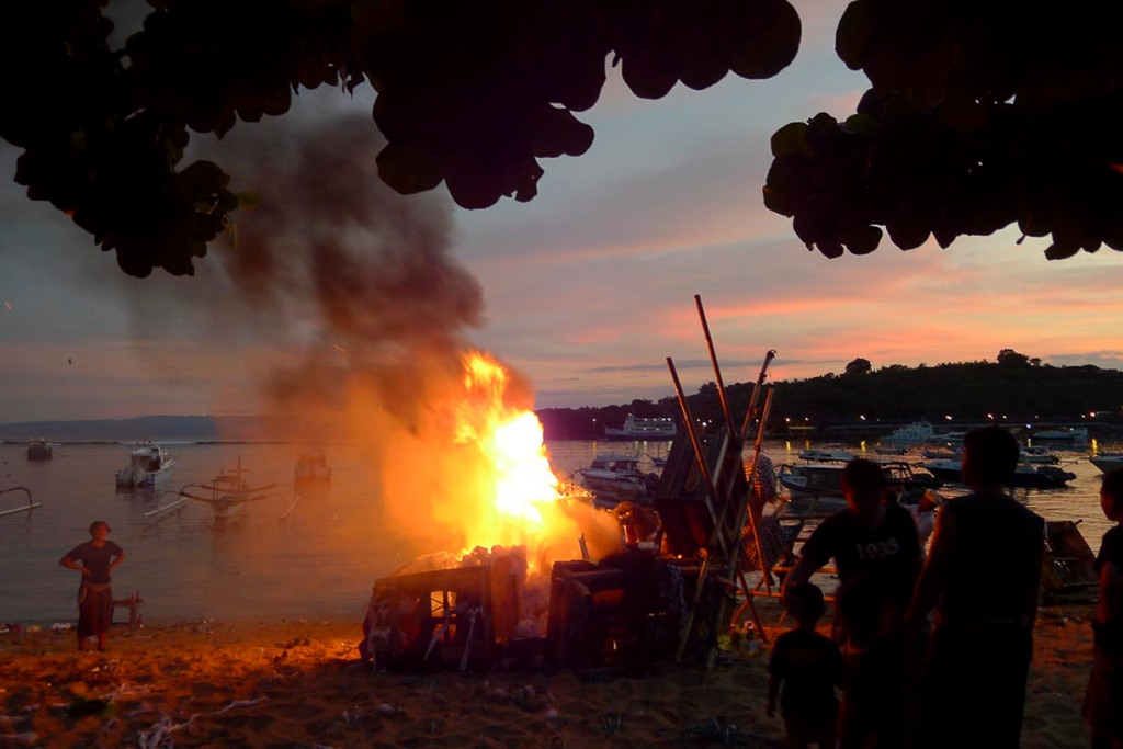 To ensure they don't come back the ogahs' remains are burnt to a cinder on the beach. © Roger Garwood 2013