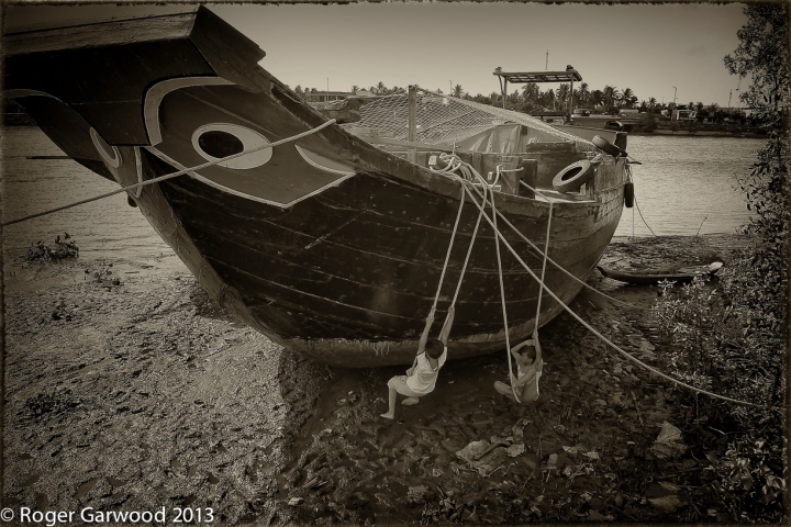 I call 'Keeping and Eye on the Kids'. This boat was moored on the river bank and the kids had rigged a couple of swings up. And no, they didn't fall into the mud. A;; boats have giant eyes painted on the bow to ward off sprits - or see where they are heading.