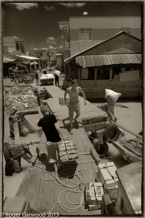 A typical day on the delta involves dropping into small towns and villages to offload cargo. This is all labour intensive work, often in high temperatures and just made for pictures.