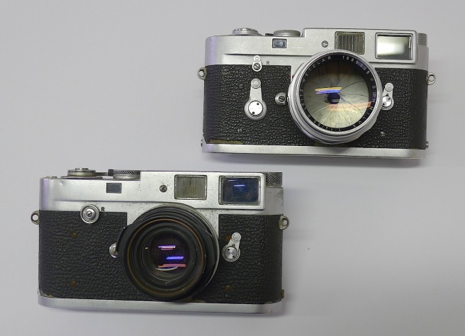 My first Leicas. For a few years they formed the basis of the equipment I used. The upper one is still very smooth and the lens, an old Summilux, is delightful. I still use it a great deal. The lower M2 was overdosed on sea water many times and finally called it quits. The lens, an old 35mm Summilux, was also drowned.